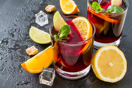 lemon: Sangria and ingredients, dark stone background, copy space, closeup
