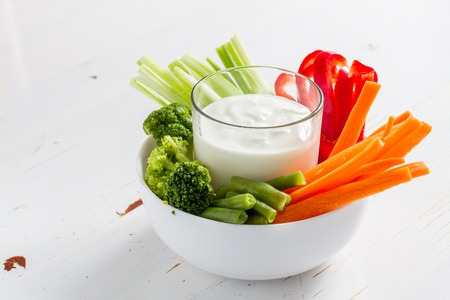 Vegetable sticks and yogurt dip, white wood background Фото со стока - 48450097