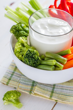 crudite: Vegetable sticks and yogurt dip, white wood background Stock Photo