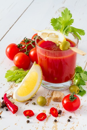 Bloody Mary ingredients on white wood background, closeup