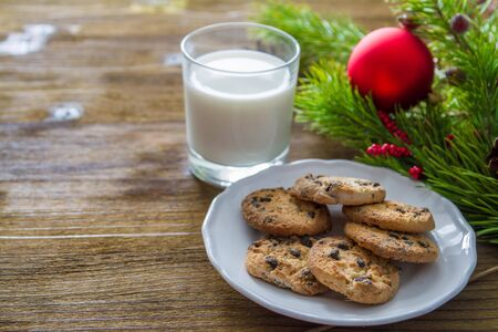 cookie on white: Cookies and milk for Santa Clause on wood background, copy space