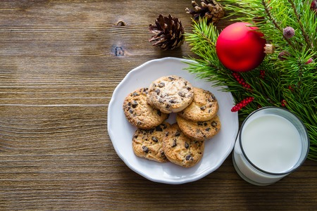 santa clause: Cookies and milk for Santa Clause on wood background, copy space