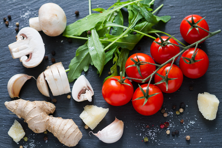 food background: italian background with mushrooms and tomatoes, top view