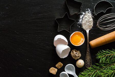 christmas food: Christmas baking background, dark stone background, copy space Stock Photo