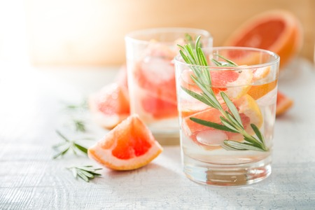 Summer refreshing drink and ingredients, copy space Imagens