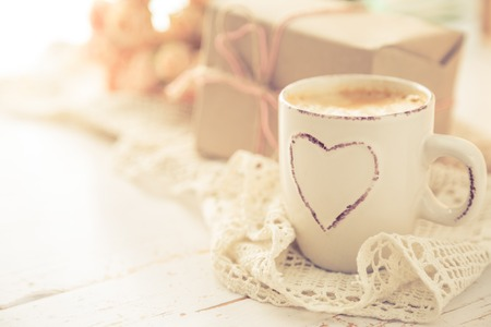 Mothers day concept - coffee present and roses copy space, toned Stock Photo
