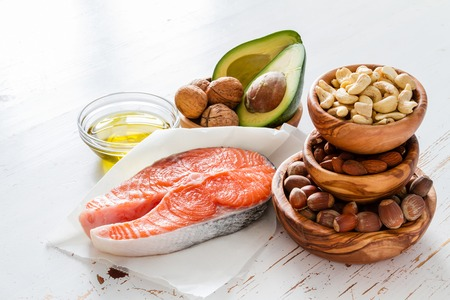 delicious food: Selection of healthy fat sources, copy space