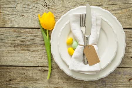 Easter table setting, rustic wood background, copy space Stock Photo
