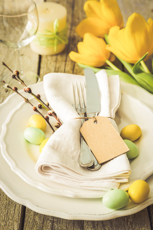 Easter table setting, rustic wood background, copy space, toned