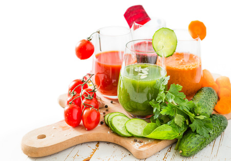 rainbow cocktail: Selection of colorful vegetable juice in glasses, copy space, isolated