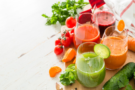 rainbow cocktail: Selection of colorful vegetable juice in glasses, copy space