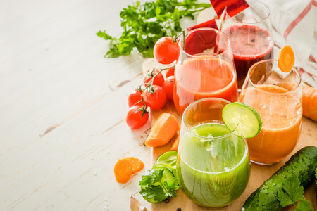 rainbow cocktail: Selection of colorful vegetable juice in glasses, copy space, toned