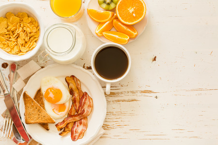 Traditional american breakfast, white background, copy space
