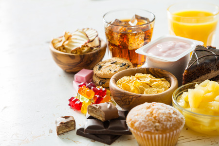 Selection of food high in sugar, copy space