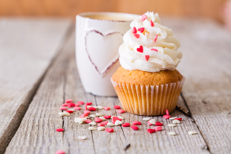 Valentines day concept - cupcakes decorated with pink hearts and coffee, copy space