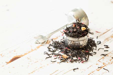 infuser: Dry black tea in infuser, copy space Stock Photo