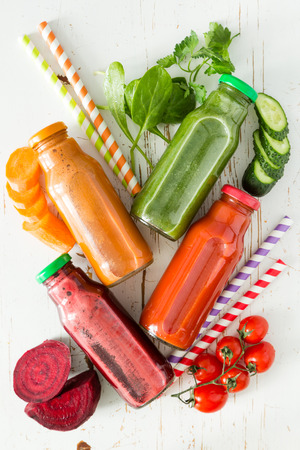 rainbow cocktail: Selection of colorful vegetable juices in glass jars, copy space
