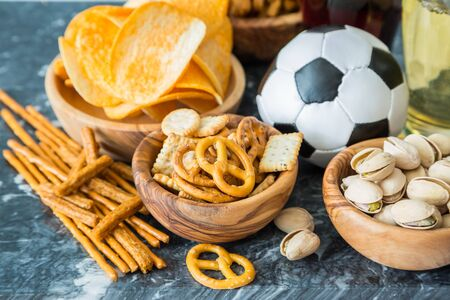 uefa: Selection of party food for UEFA champions league, copy space Stock Photo