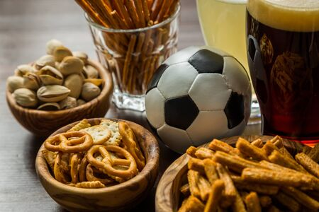themed: Selection of party food for watching football championship, copy space Stock Photo