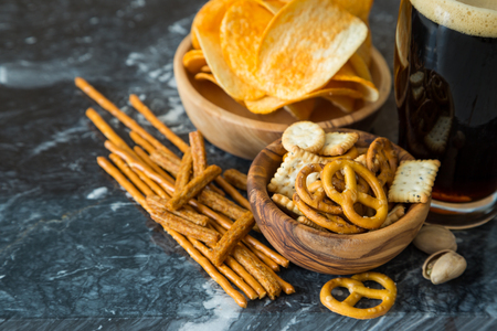 watching football: Selection of party food for watching football championship, copy space Stock Photo
