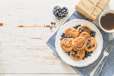 Fathers day concept - pancakes with blueberries and gift, copy space