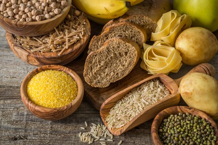 Selection of comptex carbohydrates sources on wood background, copy space Stockfoto