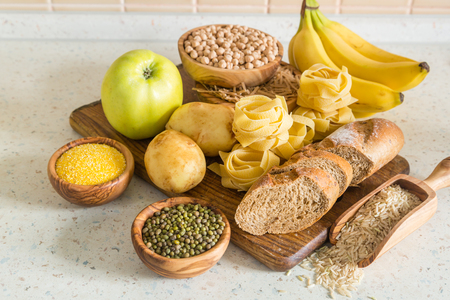 Selection of comptex carbohydrates sources on wood background, copy space Stock Photo