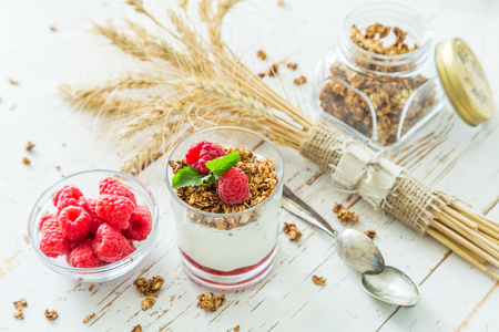 Granola with rasberry and yogurt in glass, copy space Stock Photo