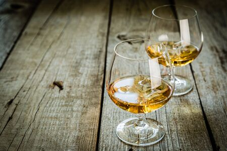cognac: Cognac in glasses on rustic backgrpund, copy space