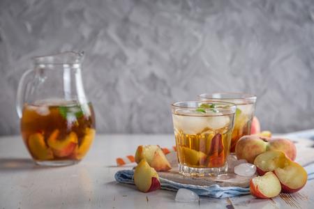 Peach iced tea in glasses, copy space