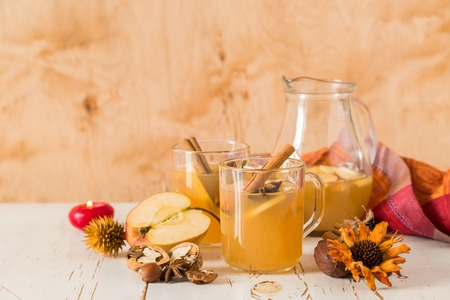 punch spice: Apple and cinnamon punch on wood background Stock Photo