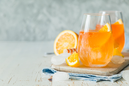 spritz: Spitz aperol cocktail in glasses, copy space