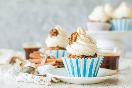 Carrot cake cupcakes with butter cream frosting, copy space Stock Photo