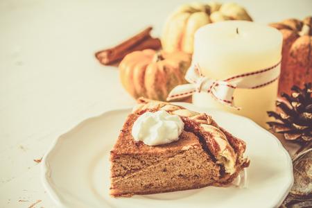 pumpkin pie: Pumpkin pie on white wood background toned
