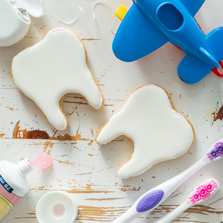 dental health: Teeth shaped cookies background with copy space Stock Photo