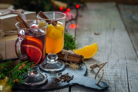 punch spice: Mulled wine and apple cider in glass cups with spices and decorations Stock Photo