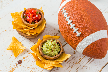 Football party food, super bowl day, nachos salsa guacamole, copy space Banque d'images