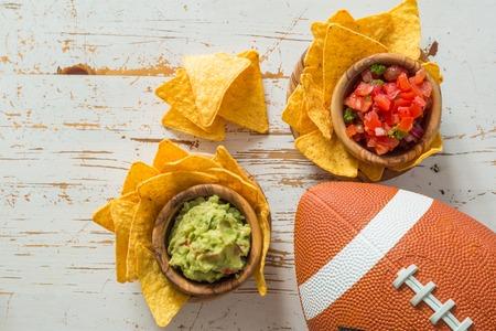 Football party food, super bowl day, nachos salsa guacamole, copy space 스톡 콘텐츠