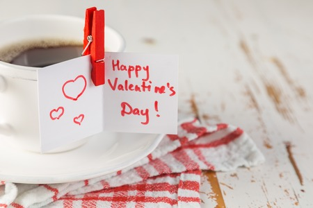 Morning coffee with Valentines day card, copy space Фото со стока