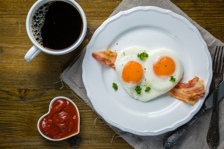 bacon love: Valentines day breakfast - eggs, bacon, ketchup, top view