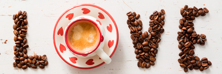 Love and coffee concept -  written with  beans