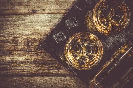 black stones: Whiskey with ice in glasses