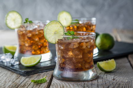 Rum and cola cocktail in glasses Stock Photo