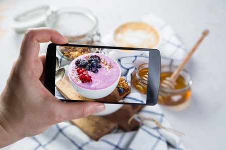 Taking photos of breakfast to phone Stock Photo - 73363049