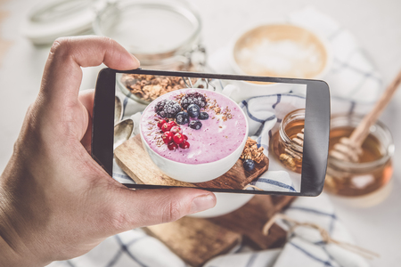 Taking photos of breakfast to phone Stock Photo - 73363052