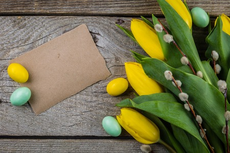 Easter card - decorations on rustic wood background Stock Photo - 73659661