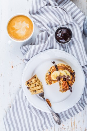 Breakfast - chocolate chip pancakes with coffee and juice Stock Photo - 73659666