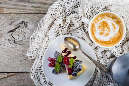 Cheesecake with berries and mint Stock Photo - 73659678