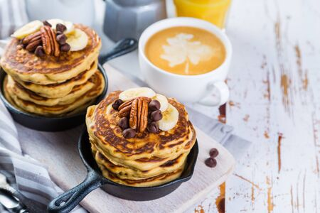Breakfast - chocolate chip pancakes with coffee and juice Stock Photo - 73659689