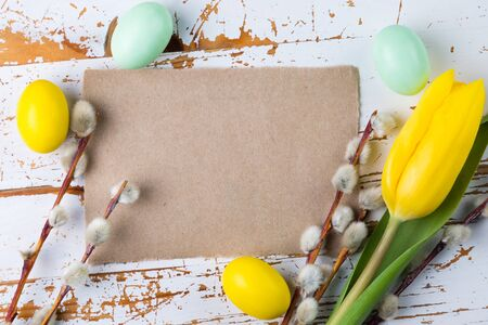 Easter card - decorations on rustic wood background Stock Photo - 73659693